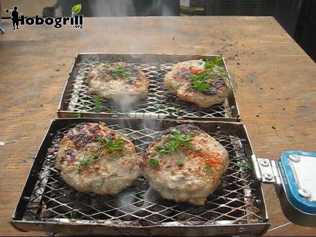 portable charcoal grill cooks on both sides, here gourmet turkey burgers